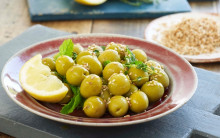 Spanish green olives marinated with sesame seeds, lemon juice and mint